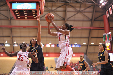 Rutgers guard, ERICA WHEELER (3), drives to the basket against La Salle University in a game at the Rutgers Athletic Center in Piscataway, New Jersey.