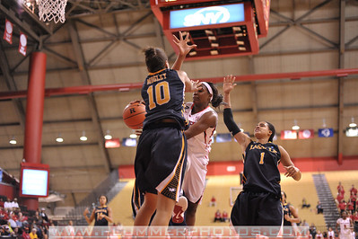 Rutgers guard, SHAKEENAH RICHARDSON (24), drives to the basket and passes the ball around La Salle University defenders in a game at the Rutgers Athletic Center in Piscataway, New Jersey.