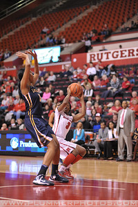 Rutgers guard, KAHLEAH COOPER (2), pump fakes a jump shot against La Salle University in a game at the Rutgers Athletic Center in Piscataway, New Jersey.
