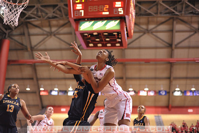 Rutgers forward, PRECIOUS PERSON (5), battles for a rebound against La Salle University in a game at the Rutgers Athletic Center in Piscataway, New Jersey.