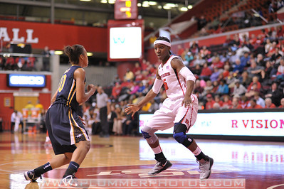 Rutgers guard, SYESSENCE DAVIS (15), puts pressure on a La Salle University ball handler in a game at the Rutgers Athletic Center in Piscataway, New Jersey.