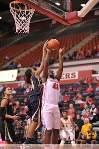 Rutgers forward, ARIEL BUTTS (43), drives to the basket and has her shot blocked by La Salle University's EBONEE JONES (14) in a game at the Rutgers Athletic Center in Piscataway, New Jersey.