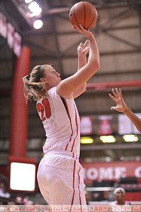 Rutgers forward, CHRISTA EVANS (20), pulls up for a jump shot against La Salle University in a game at the Rutgers Athletic Center in Piscataway, New Jersey.