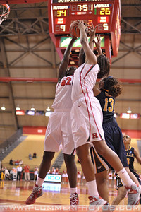 Rutgers forwards, CHELSEY LEE (50) and RACHEL HOLLIVAY, battle for a rebound with La Salle University's INDIGO DICKENS (13) in a game at the Rutgers Athletic Center in Piscataway, New Jersey.