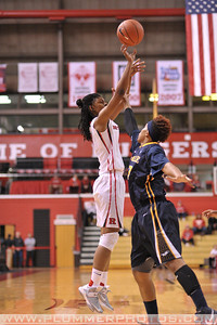Rutgers guard, PRECIOUS PERSON (5), pulls up for a jump shot against La Salle University in a game at the Rutgers Athletic Center in Piscataway, New Jersey.