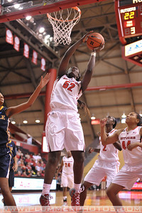 Rutgers forward, CHELSEY LEE (52), drives to the basket against La Salle University in a game at the Rutgers Athletic Center in Piscataway, New Jersey.