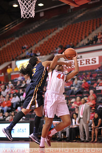 Rutgers forward, BETNIJAH LANEY (44), is fouled as she drives to the basket against La Salle University in a game at the Rutgers Athletic Center in Piscataway, New Jersey.