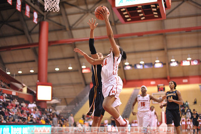 Rutgers forward, BETNIJAH LANEY (44), drives to the basket against La Salle University in a game at the Rutgers Athletic Center in Piscataway, New Jersey.