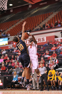 Rutgers guard, KAHLEAH COOPER (2), drives to the basket against La Salle University in a game at the Rutgers Athletic Center in Piscataway, New Jersey.