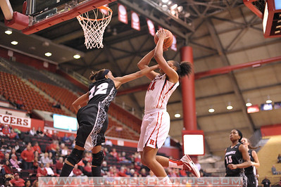 Rutgers forward, BETNIJAH LANEY (44), pulls up for a jump shot against Providence College in a game at the Rutgers Athletic Center in Piscataway, New Jersey.