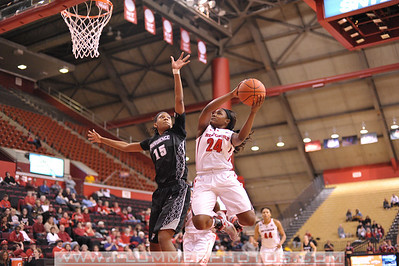 Rutgers guard, SHAKEENAH RICHARDSON (24), drives to the basket against Providence College's, CHANISE BALDWIN (15), in a game at the Rutgers Athletic Center in Piscataway, New Jersey.