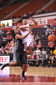Rutgers forward, BETNIJAH LANEY (44), is fouled as she drives to the basket against Providence College in a game at the Rutgers Athletic Center in Piscataway, New Jersey.