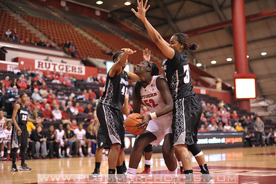 Rutgers forward, CHELSEY LEE (50), battles for position in the post against Providence College in a game at the Rutgers Athletic Center in Piscataway, New Jersey.