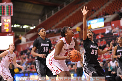 Rutgers forward, MONIQUE OLIVER (34), drives to the basket against Providence College in a game at the Rutgers Athletic Center in Piscataway, New Jersey.