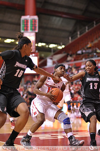 Rutgers guard, SYESSENCE DAVIS (15), drives to the basket against Providence College in a game at the Rutgers Athletic Center in Piscataway, New Jersey.