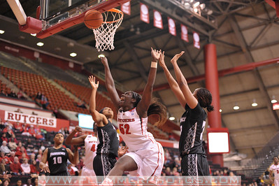 Rutgers forward, CHELSEY LEE (52), drives to the basket against Providence College in a game at the Rutgers Athletic Center in Piscataway, New Jersey.