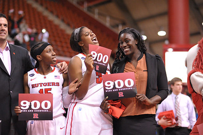 Rutgers players, SYESSENCE DAVIS (15), MONIQUE OLIVER (34), and CHELSEY LEE, celebrate head coach, C. VIVIAN STRINGER's 900th career victory after Rutgers defeated South Florida in a game at the Rutgers Athletic Center in Piscataway, New Jersey.
