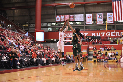 Rutgers guard, SYESSENCE DAVIS (15), pulls up for a jump shot at the halftime buzzer against South Florida in a game at the Rutgers Athletic Center in Piscataway, New Jersey.