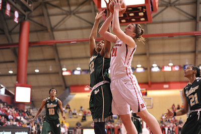 Rutgers forward, CHRISTA EVANS (21), drives to the basket against South Florida in a game at the Rutgers Athletic Center in Piscataway, New Jersey.