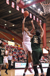 Rutgers forward, RACHEL HOLLIVAY (1), drives to the basket against South Florida in a game at the Rutgers Athletic Center in Piscataway, New Jersey.