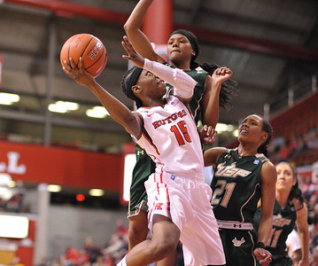 Rutgers guard, SYESSENCE DAVIS (15), drives to the basket against South Florida in a game at the Rutgers Athletic Center in Piscataway, New Jersey.