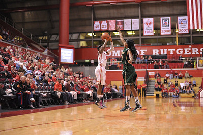 Rutgers guard, SYESSENCE DAVIS (15), pulls up for a jump shot against South Florida in a game at the Rutgers Athletic Center in Piscataway, New Jersey.