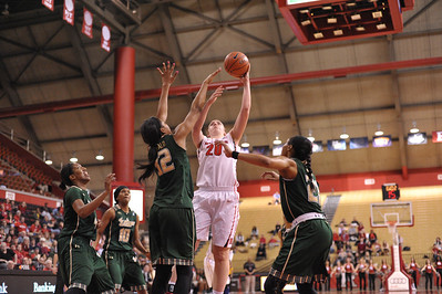 Rutgers forward, CHRISTA EVANS (20), drives to the basket against South Florida in a game at the Rutgers Athletic Center in Piscataway, New Jersey.