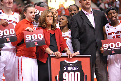 Head Coach, C. VIVIAN STRINGER and the Rutgers Women's team celebrate Stringer's 900th career victory after Rutgers defeated South Florida in a game at the Rutgers Athletic Center in Piscataway, New Jersey.