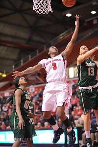 Rutgers guard, ERICA WHEELER (3), drives to the basket against South Florida in a game at the Rutgers Athletic Center in Piscataway, New Jersey.