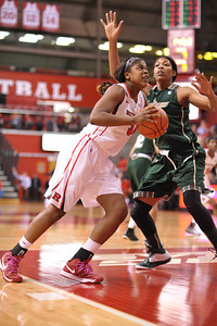 Rutgers forward, MONIQUE OLIVER (34), drives to the basket against South Florida in a game at the Rutgers Athletic Center in Piscataway, New Jersey.