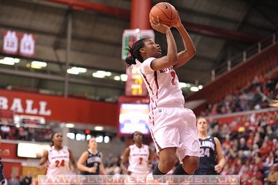 Rutgers guard, ERICA WHEELER (3), drives to the basket against Villanova in a game at the Rutgers Athletic Center in Piscataway, New Jersey.