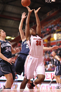 Rutgers forward, MONIQUE OLIVER (34), drives to the basket against Villanova in a game at the Rutgers Athletic Center in Piscataway, New Jersey.