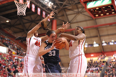 Rutgers forwards, BETNIJAH LANEY (44) and MONIQUE OLIVER (34), battle for a loose ball with Villanova's LAURA SWEENY (33) in a game at the Rutgers Athletic Center in Piscataway, New Jersey.