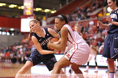 Rutgers forward, BETNIJAH LANEY (44), battles for a loose ball against Villanova in a game at the Rutgers Athletic Center in Piscataway, New Jersey.