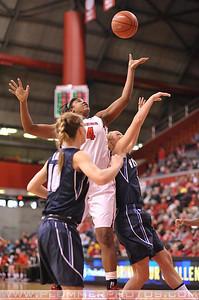 Rutgers forward, MONIQUE OLIVER (34), battles for a rebound against Villanova in a game at the Rutgers Athletic Center in Piscataway, New Jersey.