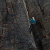 Unknown climber repels down the wall.