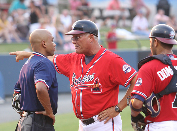 Rome Braves Coach (#12) talks to home plate umpire (Ben) after a call.