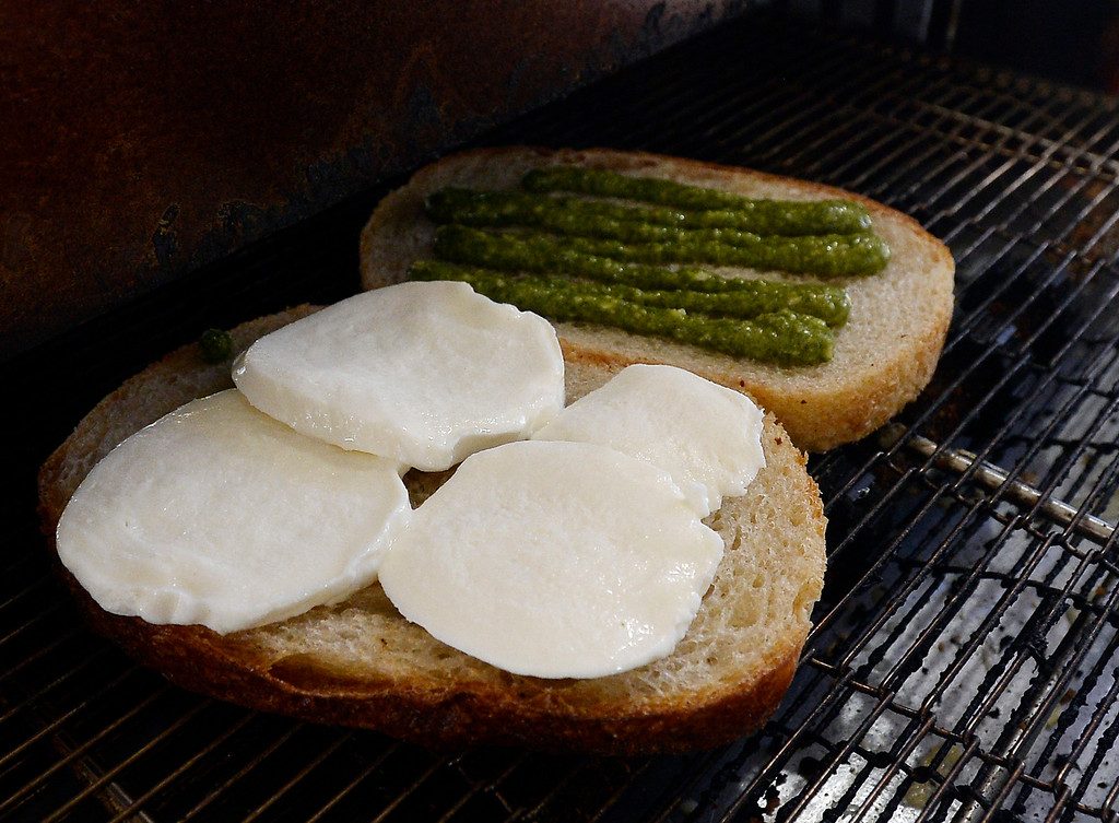 . BOULDER, CO - December 11, 2018:  The Caprese grilled cheese being grilled at Ruthie\'s Boardwalk Social on the Pearl Street Mall. (Photo by Cliff Grassmick/Staff Photographer)