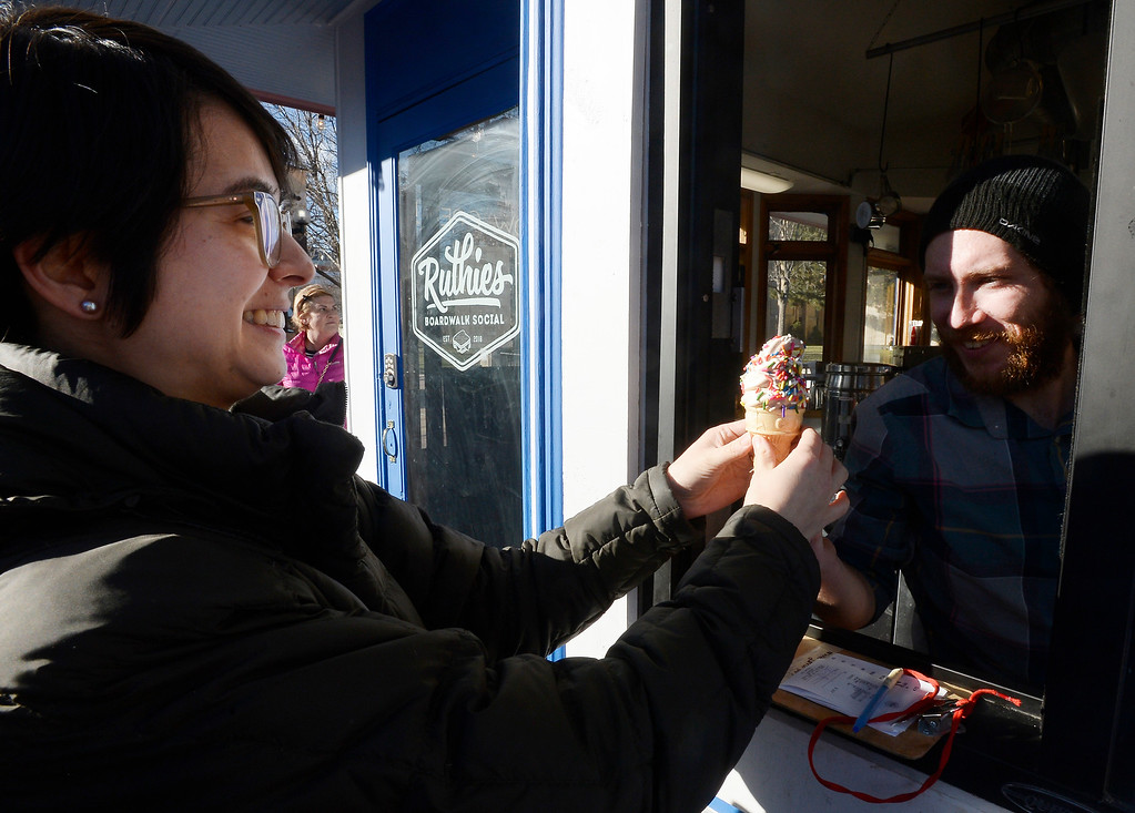 . BOULDER, CO - December 11, 2018:  Alice Henderson orders ice cream from Dan Scott at  Ruthie\'s Boardwalk Social on the Pearl Street Mall. (Photo by Cliff Grassmick/Staff Photographer)