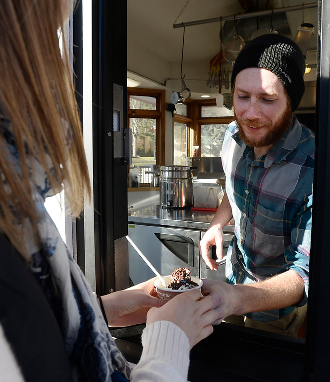 . BOULDER, CO - December 11, 2018:  Liana James orders ice cream from Dan Scott at  Ruthie\'s Boardwalk Social on the Pearl Street Mall. (Photo by Cliff Grassmick/Staff Photographer)