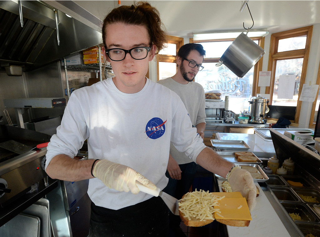 . BOULDER, CO - December 11, 2018:  James Duva takes a traditional grill cheese to be cooked. Ruthie\'s Boardwalk Social on the Pearl Street Mall is reviewed. (Photo by Cliff Grassmick/Staff Photographer)