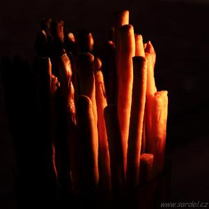 Silvestrovské tyčinky v záři svíce. ;-) Sticks in glow of a candle.