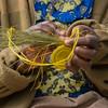 Basket weaver at the art cooperative