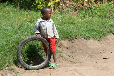 Kids rolled old tires down the street as a toy/sport