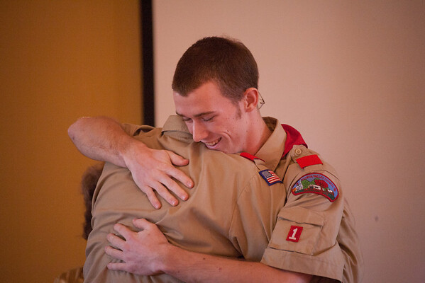 Ryan giving his father a hug after giving him his parent pin.