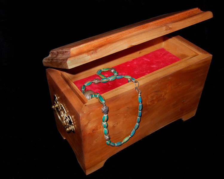 A cherry wood jewelry box I made for my mother in 8th grade.
