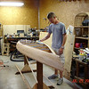 Woodshop with Ryan gluing cedar strips on the kayak.