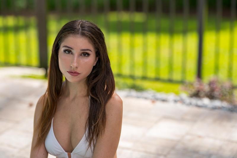 Beautiful young girlfriend sitting in a bikini