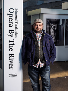 """The opening and private view of """"Opera By The River"""". Photographic exhibition by Edmond Terakopian about the opera Albert Herring at the Royal College of Music. Outdoor exhibition at Riverside Walkway, South Bank and opening party at The Deck, National Theatre, London. September 30, 2015. Photo: Neil Buchan-Grant / www.buchangrant.com"""