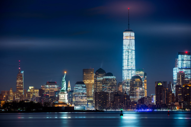 39566669 - new york city and its three iconic landmarks: statue of liberty freedom tower and empire state building